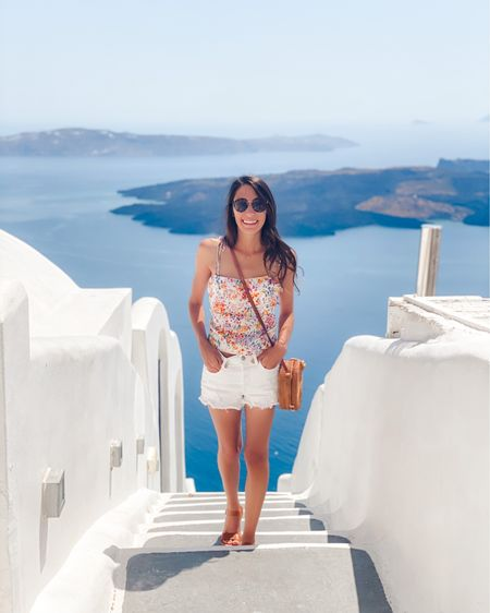 Vacation outfit, H&M tank top tie shoulders with white Levi's shorts and brown Sandals with cross body woven bag, Greece honeymoon outfit #LTKeurope #LTKtravel #LTKunder100  http://liketk.it/3h25z #liketkit @liketoknow.it