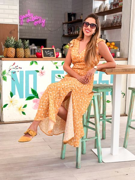 Yellow Sunshine Outfit! ☀️🌼🌻 Looking bright and shiny wearing this yellow floral dress.  I paired it with amazing yellow and gold accessories.  ..... My suede shoes are from Mango, this dress is from @RivieraCoco, I found very similar styles for you 🤩 Did you knew Swarovski offers amazing sunglasses? Well mine are tortoiseshell color with gold frame and the signature Swarovski cristals on the sides.  .....  You can instantly shop all of my looks by following me on the LIKEtoKNOW.it shopping app http://liketk.it/2VoTB  Proud influencer of @liketoknow.it @liketoknow.it.europe @liketoknow.it.home  .....  #liketkit #LTKtravel #LTKeurope #LTKunder100 #LTKunder50 #LTKsalealert #yellowdress #yellowoutfit #marbella #luxefashionblog #fashionchallenge
