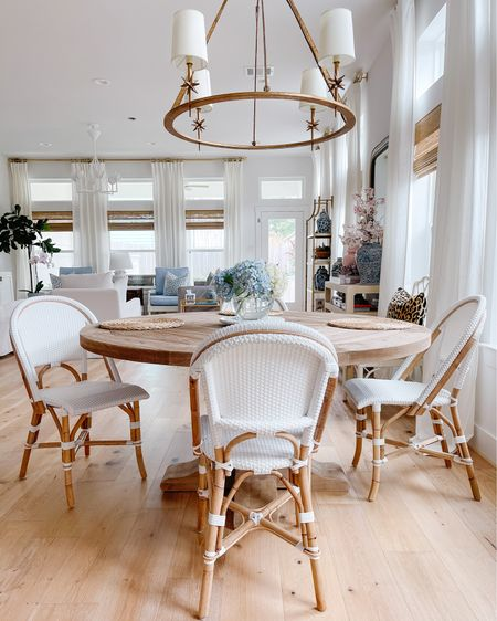 Creating a dining area in our open-concept home was an exciting challenge! I opted for a round table than can seat 6 and bistro style chairs (which are great for young families because they wipe clean!) The etoile light fixture was the perfect way to anchor the space and make it feel like its own little nook off the kitchen. Mixing and matching lighting in an open concept space can be a major decorating challenge, but finding fixtures that complement one another while making their own statements felt like the greatest win! Shop our dining space and our entire home by following me @veronabrit in the @liketoknow.it.home  LIKEtoKNOW.it app! http://liketk.it/3fhlG #liketkit @liketoknow.it #LTKhome