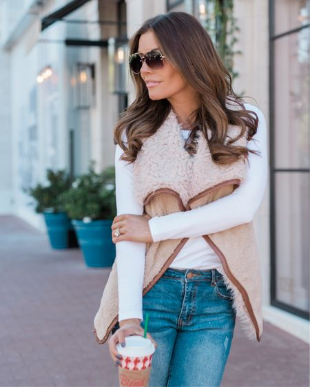 Weekend ready ☕️🧡 living in this cozy, faux fur vest! I love the brown leather trim detail - it pairs perfectly with your favorite jeans, booties and my $15 aviators   http://liketk.it/2yi0S @liketoknow.it #liketkit #LTKholidaystyle #LTKholidaywishlist #LTKsalealert Shop your screenshot of this pic with the LIKEtoKNOW.it app