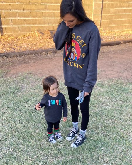 Affordable style Winter ootd inspo Casual style  Christmas sweatshirt Faux leather leggings Toddler knit leggings toddler sweatshirt Mother daughter outfit Converse outfit  http://liketk.it/32VWu #liketkit @liketoknow.it #LTKgiftspo #LTKfamily #LTKstyletip @liketoknow.it.home @liketoknow.it.family