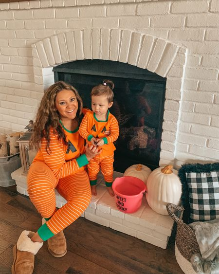 Matching family pajamas. Halloween pajamas. Family jammies. Family pjs. Toddler pajamas. Toddler girl. Halloween fun. Pumpkin decor. White pumpkins. Target style. Target fashion. Target finds. Fall living room decor.   #LTKHoliday #LTKfamily #LTKSeasonal