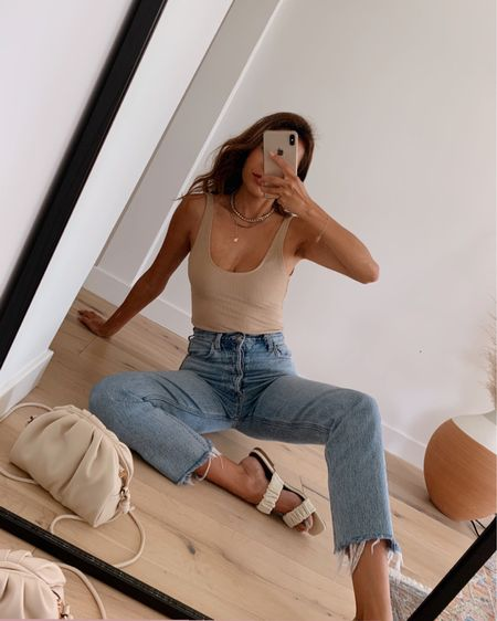 Outfit decisions made easy when you have a comfortable bodysuit, your go-to jeans, and cute slides. 👌 http://liketk.it/3gDw7 #liketkit @liketoknow.it #LTKshoecrush #LTKstyletip