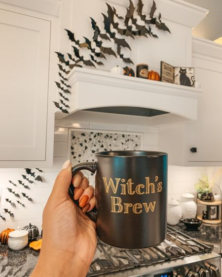 Witch's Brew 🔮 #targethalloween Mama needs her morning brew! Linking this exact festive mug, bats and all Halloween decor I could in the @shop.LTK app here  #halloween #batdecor #liketkit #spookyseason #falldecor #whitekitchen #mug #halloweenhome #kitcheninspo #ltkhome #ltkseasonal #halloweenspirit #fallnails #coffeemug #bats #halloweendecorations  #batty #kitchendecor #fallinspo #farmhousestyle #fallhomedecor #mugs #targethome #halloweenhomedecor #fallmug #brownnails #witchesbrew #witchdecor   #LTKHoliday