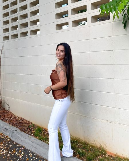 Try this next style combo when you go to work! Cami top and high waisted bootcut pants from Express http://liketk.it/3jQGL #liketkit @liketoknow.it You can instantly shop my looks by following me on the LIKEtoKNOW.it shopping app #LTKstyletip #LTKworkwear #LTKbeauty