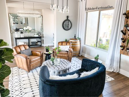 Our black velvet curved loveseat is on major sale. This is the backside of it. So chic and modern. Leather chairs, topped it ottoman, oversized wall mirror, crystal chandelier, living room furniture, barrel room, wine bar room, sitting room, family room furniture, a Modern Farmhouse Glam. Pottery barn Wayfair Target home decor 60% off my rug and site wide with coupon code MFG60 Follow my shop on the @shop.LTK app to shop this post and get my exclusive app-only content! Wooden Wine bottle holder. Wine rack.   #liketkit #LTKsalealert #LTKhome @shop.ltk http://liketk.it/3n8an