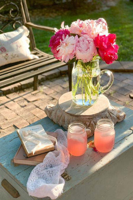 Crisp cold water or fresh lemonade 🍋 tastes better out of a mason jar. 💦  Glass pitcher from Target  Antiqued Carved Pedestal Mason Jars Pink peonies  Antique Books Patio decor   http://liketk.it/3hWn9 #liketkit @liketoknow.it #LTKunder50 #LTKhome #LTKstyletip @liketoknow.it.home @liketoknow.it.family Follow me on the LIKEtoKNOW.it shopping app to get the product details for this look and others