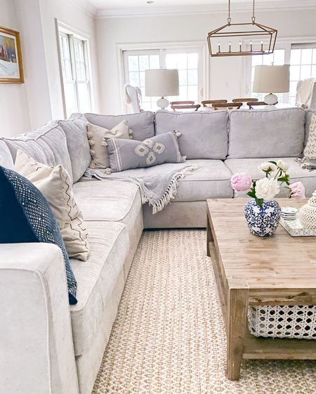 Living room, family room decor, gold chandelier, coffee table, throw pillows, serena and lily pillows, captain chairs, white captain chairs  http://liketk.it/3gRPi #liketkit @liketoknow.it @liketoknow.it.home #LTKhome