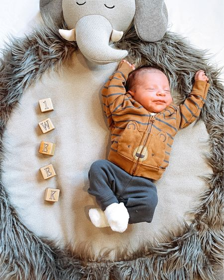 One week with our sweet Christian! 💙  The fastest, happiest week of our lives. You love sleeping, kissy faces, & snuggles and bring joy to everyone around you!   Linking baby monthly milestone blocks & similar baby boy outfit & baby play mat in the @liketoknow.it app - screenshot any of my pics to shop & give me a follow! http://liketk.it/39PuO #liketkit   @liketoknow.it.family #LTKbaby #LTKunder50 #LTKfamily