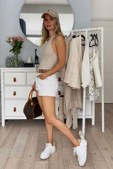 I'm 5'5 and I'm wearing a waist 26 in the white shorts. I'm normally a w25 and these are big on me. Pick your normal size.  My beige belt is 75 cm long. It fits perfectly on the hip, but I had to make a smaller hole for the waist.  My pure star sneakers are true to size.   The beige body is old, but I have linked some similar ones ❤️  #LTKeurope #LTKSeasonal #LTKstyletip