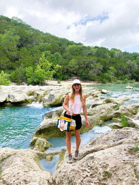 Texas hiking essentials - cute white baseball cap, colorful trendy cooler, lululemon pink crop top, lululemon black Fanny pack (I BRING IT EVERYWHERE), and also tagging my fav hiking shoes   #LTKswim #LTKfit #LTKtravel