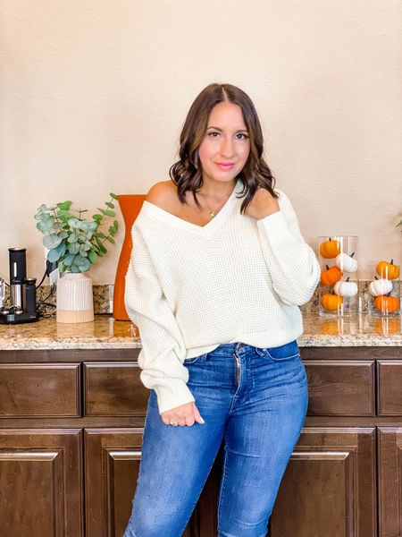 Nordstrom style finds.  Women's v-neck sweater. It can be worn on or off the shoulder. Runs tts.  Good American jeans run tts.  Thanksgiving outfit.  Cute fall outfit    #LTKunder50 #LTKunder100