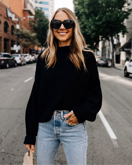 This oversized black sweater is so cozy and perfect for fall! Love the oversized and slouchy fit (wearing a small) #falloutfit #sweaters #levis   #LTKunder100 #LTKstyletip #LTKunder50