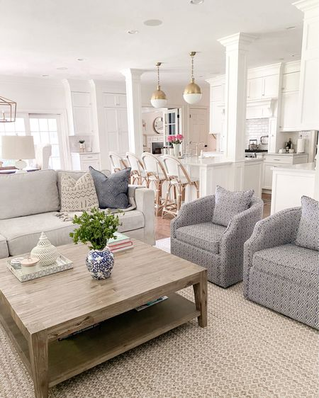 Family room layout, family room decor, swivel chair, blues and neutrals, coffee table, large coffee square table, lovesac, serena and Lily barstools  http://liketk.it/3fi3C #liketkit @liketoknow.it @liketoknow.it.home #LTKhome