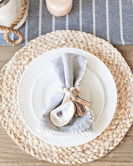 These oyster napkin rings make the perfect addition to your summer dinner table! Napkins are from HomeGoods, but I've linked some others that would pair perfectly with these napkin rings!  @liketoknow.it @liketoknow.it.home #liketkit #LTKfamily #LTKunder50 #LTKstyletip http://liketk.it/3jMRc  summer decor, summer home decor, summer home, coastal decor, beach house decor, beach decor, beach style, coastal home, coastal home decor, coastal modern, coastal interiors, coastal decorating, coastal house decor, coastal farmhouse decor, neutral home decor, tablescapes summer, tablescapes spring, tablescapes for spring, tablescape blue, tablescape ideas, tablescapes neutral, coastal table decor, coastal dining room, tablescape farmhouse, coastal farmhouse decor, coastal table setting, coastal tables, chargers, jute chargers, chargers plates, spring tablescape, summer tablescape, napkin rings, white dinnerware, white dinnerware set, white dinner plates, blue and white home, blue and white tablescape, blue and white table runner, neutral table runner, water hyacinth placemats, Target home, Target finds, target style, pottery barn dining room, pottery barn dining table, pottery barn dining room table, light wood dining table, dining table farmhouse, dining table farmhouse modern, dining table coastal, farmhouse dining table, dining table with leaf, oyster napkin rings, summer napkin rings, coastal napkin rings, napkin holder, napkins, blue and white napkins, coastal napkins, cloth napkins, summer napkins, summer chargers, water hyacinth chargers, woven placemats, crate and barrel, crate & barrel