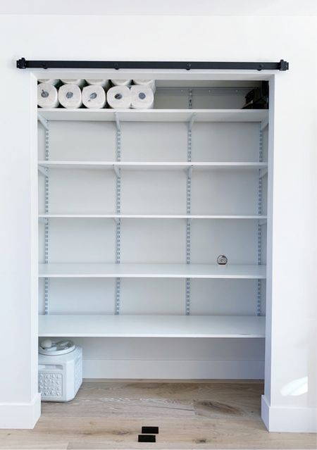 Given the amount of space, only one shelf was sufficient without crowding, but doesn't it make an incredible impact? Any time I can edit your space by way of adding shelves instead of bins / containers…it's a win in my book! || #pantry #pantryorganization #storage #shelf  #LTKhome