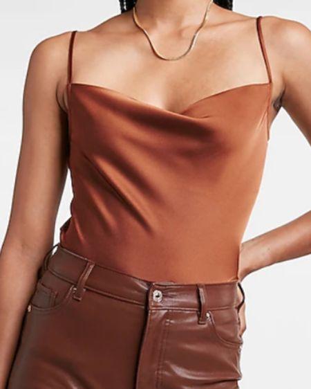 The perfect cami from Express! http://liketk.it/3jN4g #liketkit @liketoknow.it Download the LIKEtoKNOW.it shopping app to shop this pic via screenshot #LTKsalealert #LTKstyletip #LTKworkwear