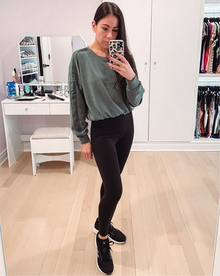 I love him he's high waisted compression leggings from express. They are such a great fit uncomfortable material. They are currently under $50. I'm pairing them with my new teal sweatshirt that I absolutely love the fall and winter, under $100. Either of these would make a wonderful gift for her. Her.  #LTKunder100 #LTKfit #LTKHoliday