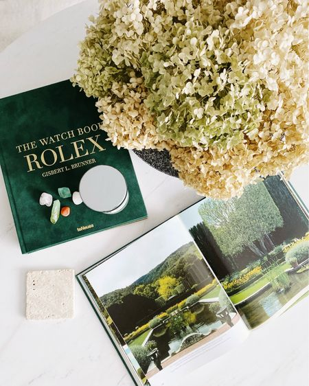 A fresh, mid-summer, coffee table setting, featuring a few of my favourite things: hydrangeas, Rolex, and @jomalonelondon Lime Basil & Mandarin candle. 🌿🍊  #alexanderkentonhome #homedecor #torontohomes  #LTKhome #LTKstyletip