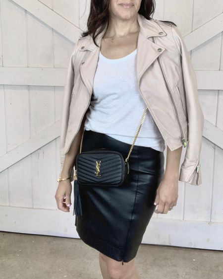 My moto leather jacket is sold out in pink but is $100 off right now in black brown and bone.  I also have it in black because it's so good.  I wear the XS. Runs TTS.  Wearing my favorite basic white tank in XS. TTS.  My Saint Laurent black crossbody also comes in white, grey and nude. http://liketk.it/3fsMN #liketkit @liketoknow.it #LTKsalealert #LTKitbag #LTKstyletip Shop your screenshot of this pic with the LIKEtoKNOW.it shopping app