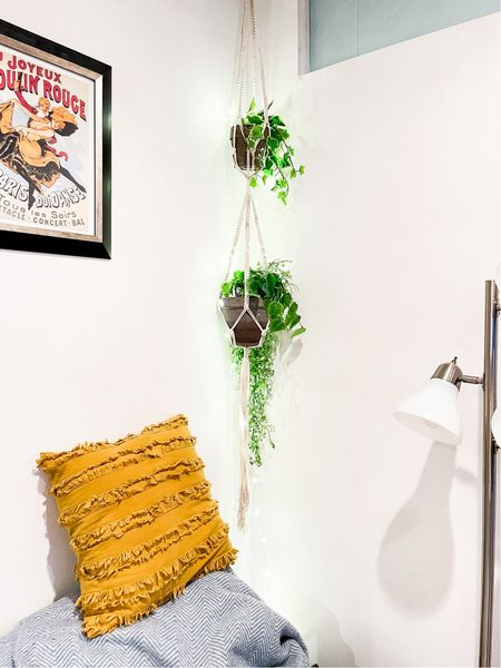 We are loving our macrame plant hangers, faux plants and fairy lights in our living room! #LTKhome #LTKunder50