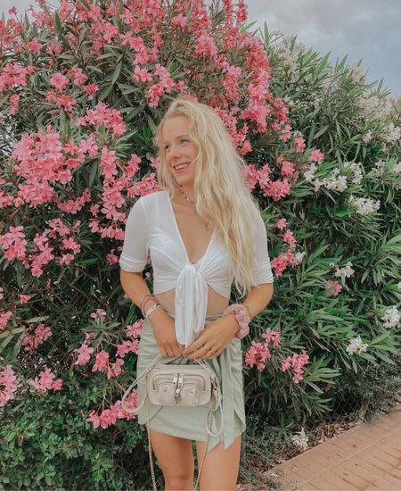Hi loves! I am back from my summer holiday to Mallorca 🌴✨ #skirt #greenskirt #style  #LTKeurope #LTKstyletip #LTKSeasonal