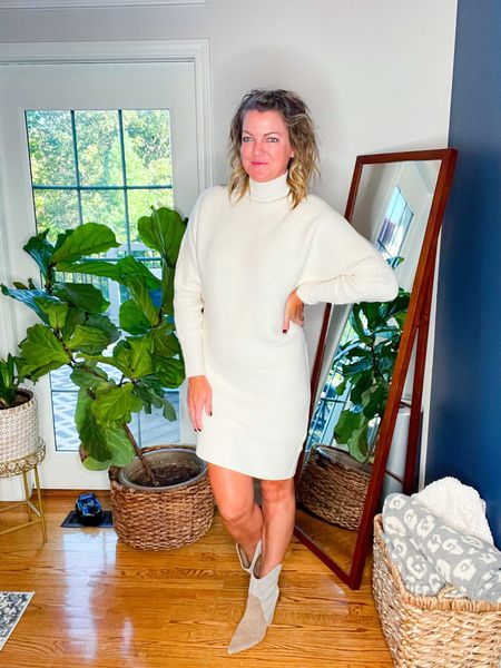 This asymmetric sweater dress is so good. It is TTS   These boots are so dang cute and TTS.     #LTKstyletip #LTKshoecrush #LTKSeasonal