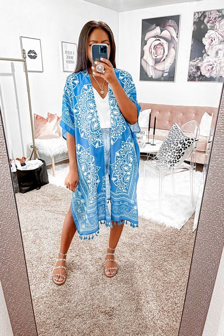 """5'4"""" wearing an xs in the tank and shorts. Great coverup to layer with or rock as a swimsuit coverup. http://liketk.it/3gAXK #liketkit @liketoknow.it found it on Amazon, Amazon fashion, beach coverup, swimsuit coverup, beach must have, vacation must have, pool essential, vacation outfits, flat sandals, Steve Madden, shorts, kimono, paper bag shorts, tank top, dainty jewelry.   #LTKunder50 #LTKstyletip"""