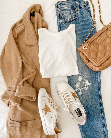 I know we're well away from sweater or coatigan season, but this is such a great look for travel or air-conditioned places (coffee shops anyone?! 🥶 ❄️). This is my first and only pair of Golden Goose sneakers, and I really love them—the color is so unique yet can be worn with just about anything.   501 skinny jeans are old—similar pair linked!  #LTKunder100 #LTKshoecrush #LTKstyletip