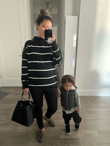 Back at it with this guy. He has the knee pop down! It's definitely sweater weather in nyc. This mock turtleneck striped sweater is an easy fall outfit. It looks put together and can definitely be worn as part of a workwear outfit. I'm wearing an XS. 26 weeks pregnant. It's oversized for a slouchy fit. I'm wearing it with skinny jeans and fur  mules. Target style. Mom outfit. Black bucket bag for toys, of course.  #LTKworkwear #LTKkids #LTKbump