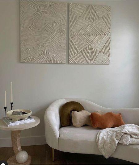 Cozy yet elegant corner featuring a curvy fluid sofa.   #LTKHoliday