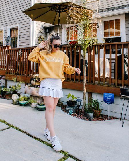 Feeling sporty chic in this outfit! I love my adidas sneakers and golf skirt for spring days. ☀️ #liketkit @liketoknow.it http://liketk.it/3bghG #LTKSpringSale #LTKunder50 #LTKshoecrush