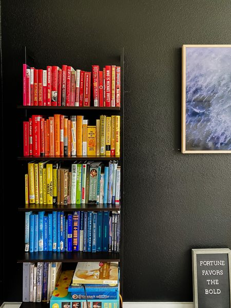 Home office decor with a ladder bookshelf and organizing our books by color. Linking the exact shelf and our samsung frame tv and bezel along with our favorite books.   #LTKstyletip #LTKhome