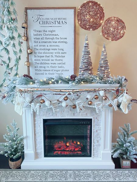 """""""Twas the Night Before Christmas"""" - a Twinkle Lights and Cornbread original design ❤️  Nothing says the night before Christmas more than a crackling fireplace, twinkling trees, snow covered pine cones, knit stockings ready to be filled, and the beautiful silence of a quiet home with everyone nestled in their beds anxiously awaiting the faint jingle of Santa's sleigh... 🤍   Fireplace, farmhouse fireplace, mantle design, Christmas mantle, farmhouse Christmas, white fireplace, Christmas bell garland, cowbells, fireplace decorating ideas, flocked Christmas trees   http://liketk.it/33TRq #liketkit @liketoknow.it @liketoknow.it.home #LTKgiftspo #LTKsalealert #LTKhome"""