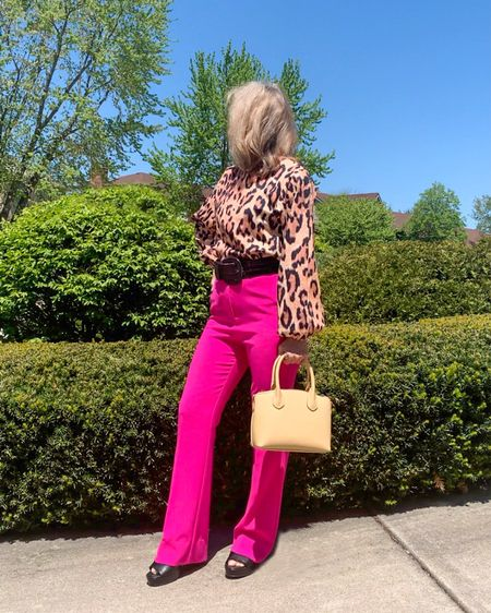 Go bold or go home! Well, I don't alway feel like being so flashy but the best way to tone down a wild leopard print top is with a bright and bold piece, like these hot pink pants! In fact, any bright color wide leg pant will do. I pulled the 2 pieces together with a wide black belt, black platform sandals and pastel yellow bag to pick to some of the color in the leopard print top.  Are you afraid of wearing bright colors and prints?