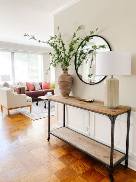Beautiful console in the entryway styled with a round mirror, lamp and faux stems.  Console decor, home decor, modern farmhouse, round mirror, table top decor  #LTKhome