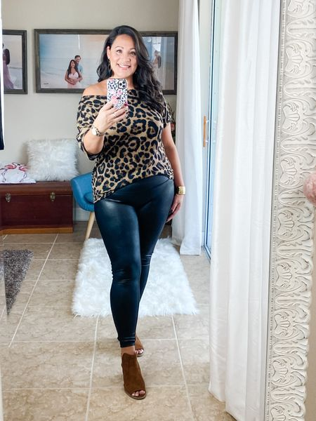 Leopard print off the shoulder tee. I'm wearing size XL for an oversized fit. These high waisted, leather leggings are awesome, I sized up for a comfortable fit not skin tight. They are dupes for the spanx leggings. http://liketk.it/2U9Is #liketkit @liketoknow.it #LTKcurves #LTKstyletip #LTKunder50