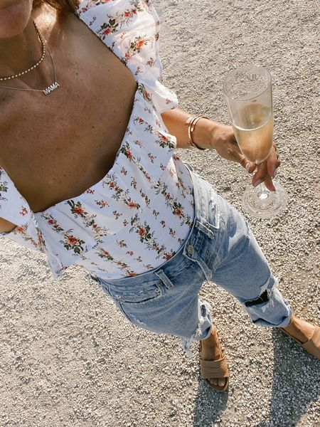 Floral ruffle linen top (runs tts with a ruched back) and 90's jeans (recommend sizing down 1-2 sizes). 15% off slides with code Shannon15 //   #LTKstyletip