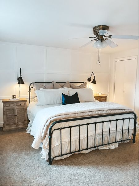 Farmhouse bedroom with white and grey bedding and black cast iron bed 🤍 Amazon sheets are on sale   #LTKsalealert #LTKhome
