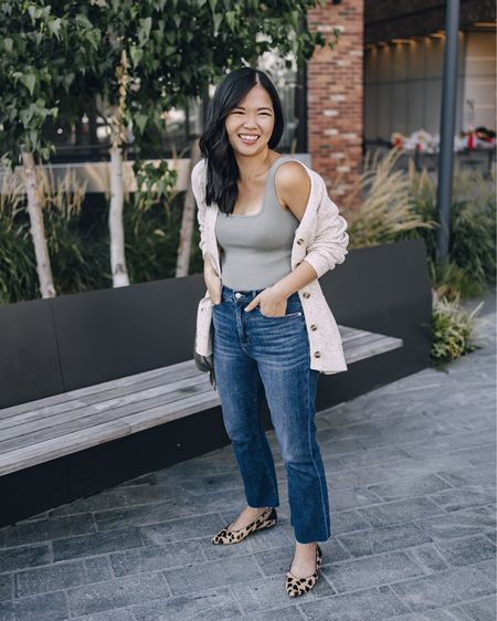"""This is my go-to fall outfit: sage green sweater tank (XS), cream chunky cardigan (XS), high waisted flares jeans (27 – I'm 5'2"""" and since these jeans had a raw hem, I ended up cutting another 2 inches off the hem), similar leopard flats.  Fall style, casual outfit, Abercrombie, LOFT, fall trends, flare jeans, kick crop jeans."""