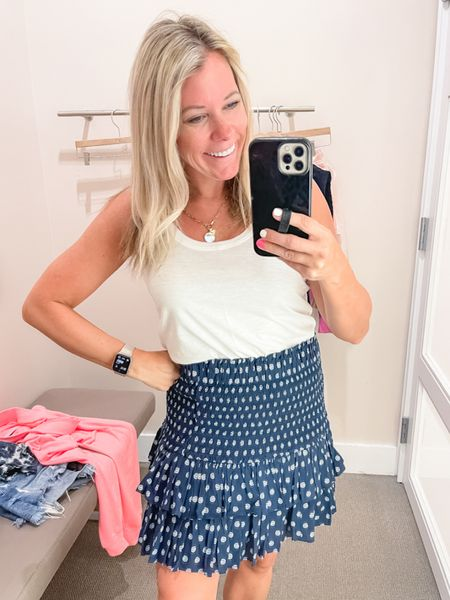 Love the smocked waist skirt with this white tank which are both 50% off right now. Wearing a size small in the skirt and the tank top. Summer outfit ideas summer skirts tank top loft sale  #LTKunder50 #LTKSeasonal #LTKsalealert