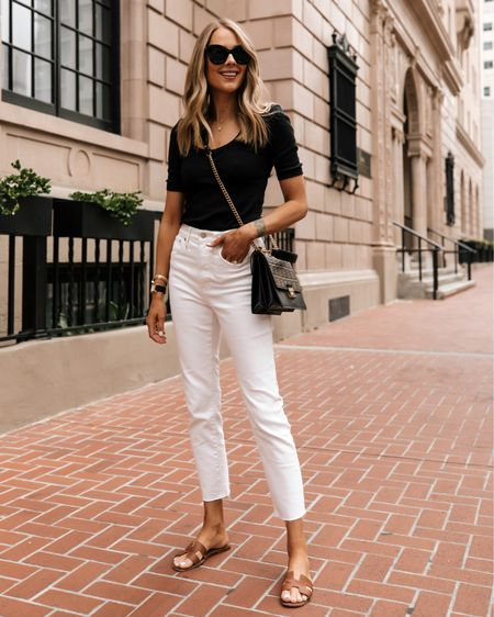 Minimal summer outfit in white jeans. Black top (tts / small), white jeans (tts) Hermès sandals (linked similar) fendi handbag #sunmeroutfit #whitejeans #sandals #fendi http://liketk.it/3hmE6 #liketkit @liketoknow.it #LTKstyletip #LTKshoecrush #LTKunder100