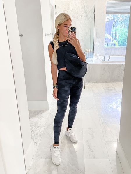 LUV'ing this free people cropped tank. Think I may grab some more colors. Also these black camo leggings are a must for fall and winter! My white sneakers are men's so I sized down a full size. And wearing this crossbody fannypack bag every single day! You will not regret this purchase!   #LTKunder100 #LTKshoecrush #LTKfit