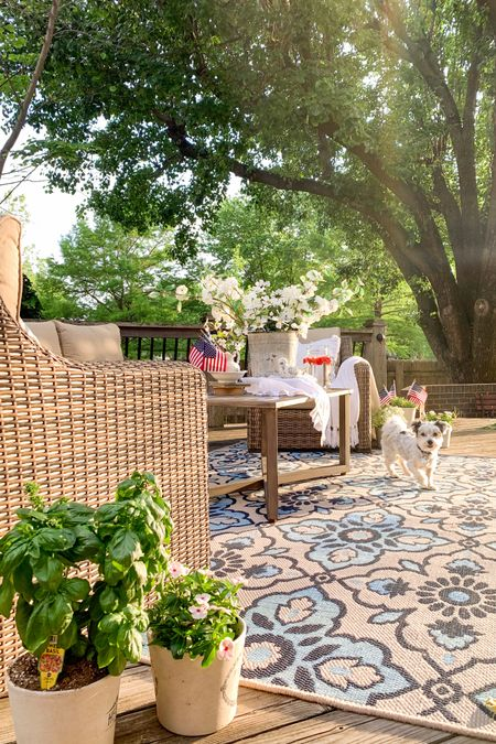 Get your Patio Summer Ready!! ❤️💙  Create a warm and welcoming outdoor space with this high quality 4-Piece Sofa Conversation Set patio set! The set includes the outdoor sofa, 2 outdoor chairs and the coffee table. This patio furniture is beautiful and looks like wicker, but it is all-weather wicker, which is a different type of material that is moisture/mold/mildew resistant and incredibly durable!🙌 We've enjoyed this set for 3 years already and know it will last many years to come!  Our friends and family love to gather around this comfy & pretty spot!🌿   Follow me on the LIKEtoKNOW.it shopping app to get the details for these products  and others!  #LTKseasonal #competition #summerpatio #patrioticdecor #redwhiteandblue  #outdoorfurniture #wickerfurniture @liketoknow.it   http://liketk.it/3ge4i #liketkit @liketoknow.it.home @liketoknow.it.family   #LTKhome #LTKfamily #LTKsalealert