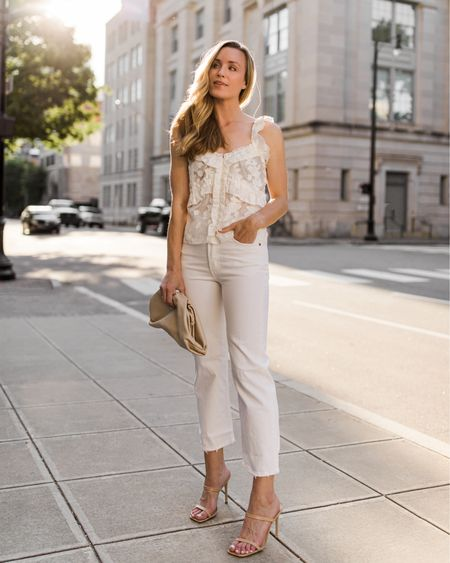 An easy summer date night outfit — I'm such a sucker for all white looks…they're so chic! 🤍 This blouse is by my favorite French brand, Sezane! Jeans are under $100 and fit TTS—the perfect length for heels, sneakers, and sandals. I linked similar look alike blouses, heels, and bags as well! Xo! ✨    summer date night outfit, summer date night outfits, ruffled blouse, sezane, white blouse, sleeveless blouse, feminine blouse, white jeans outfit, all white outfits, summer heels, heeled sandals, feminine style, summer fashion, neutral sandal heels, heeled sandals neutral http://liketk.it/3fJuy #liketkit @liketoknow.it