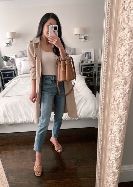"""Sale alert: Levi's jeans on sale! Wearing wash """"shut up"""" in size 24 with hems cut. Trench is H&M but an old color so I linked a few similar options in petite sizing. Ann Taylor tank c/o in xxs paired with the super comfy NEWAI bra. Express quilted sandals in size 6, Vedern 15"""" toggle necklace from Etsy and Polène numero huit bag c/o  #LTKsalealert #LTKSeasonal #LTKshoecrush"""