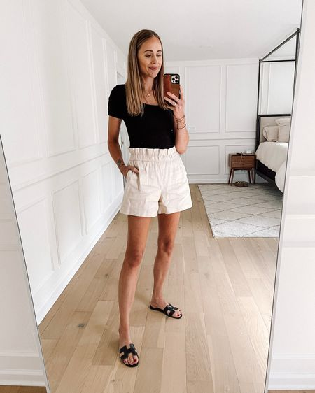 Daily look! This black bodysuit is from #amazonfashion (small / tts) and so comfortable! Love these lightweight linen blend paperbag waist shorts (size down) with my black Hermès sandals for #summeroutfit #amazonfinds   #LTKunder50 #LTKstyletip #LTKunder100