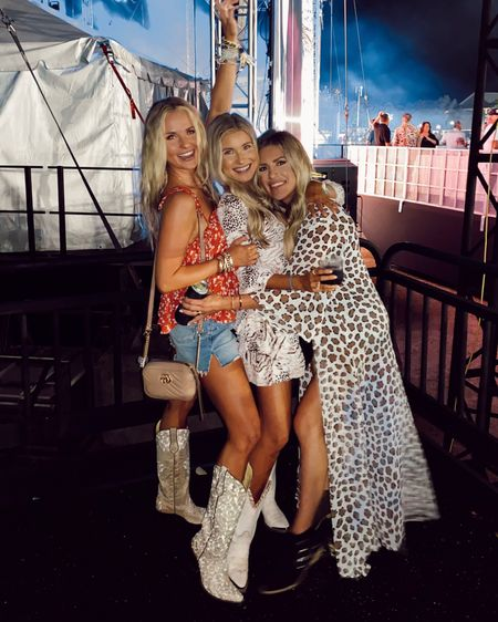 Summer country concert outfits with distressed Jean shorts, distressed Levi shorts, Abercrombie denim, and cowboy boots, women's cowboy boots for summer concert and summer concert outfit ideas! @liketoknow.it #liketkit #LTKtravel #LTKstyletip #LTKsalealert http://liketk.it/3gWge