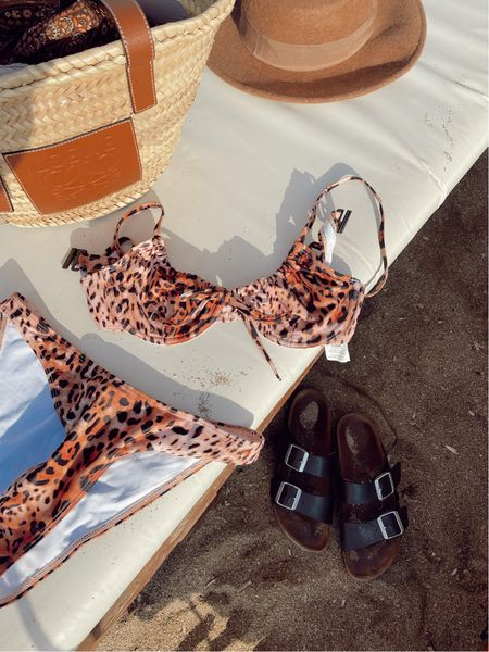 Missguided leopard print bikini with Loewe basket bag and black Birkenstock's