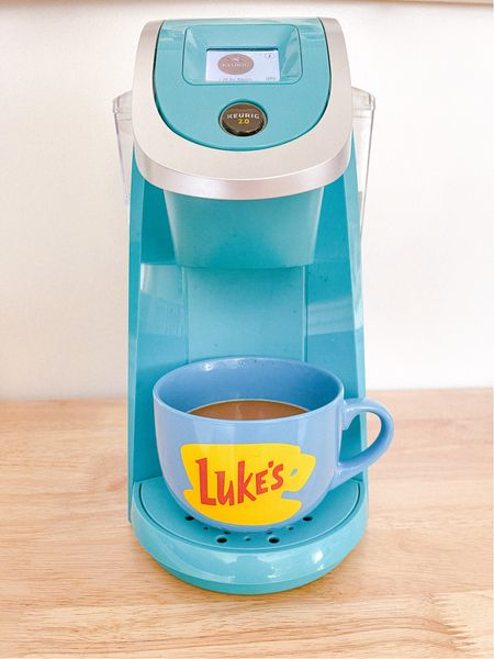 My new Luke's coffee mug is the perfect gift for the coffee + Gilmore Girls lover! ☕️ It's generously sized, and come in 3 colors: Blue (pictured) Mint and Red! My Teal Keurig coffee maker is and older model; but the color is still available! It's such a fun pop of color in the kitchen! ✨  #LTKSeasonal #LTKfamily #LTKhome